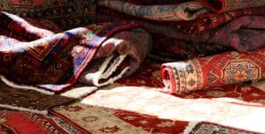 Pile of red Afghan carpets